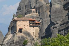 Meteora in Greece. Meteora literally in the middle of the air from the greek META ' in the middle and AER air, suspended in the air or in the heavens above) is a Stock Photos