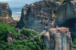 Meteora, Greece. Mountain scenery with Meteora rocks and Roussanou Monastery Royalty Free Stock Photo