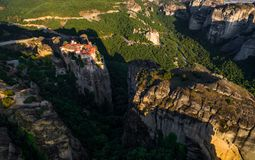 Meteora monasteries drone view at sunset. The Meteora is a rock formation in central Greece hosting one of the largest and most precipitously built complexes of royalty free stock images