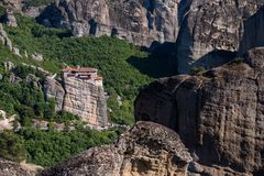 Meteora monasteries from Greece at sunset. The Meteora is a rock formation in central Greece hosting one of the largest and most precipitously built complexes of stock photo