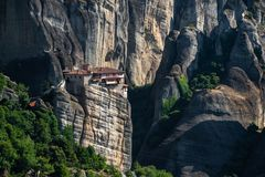 Meteora monasteries from Greece at sunset. The Meteora is a rock formation in central Greece hosting one of the largest and most precipitously built complexes of royalty free stock photos