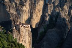 Meteora monasteries from Greece at sunset. The Meteora is a rock formation in central Greece hosting one of the largest and most precipitously built complexes of royalty free stock image