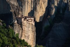 Meteora monasteries from Greece at sunset. The Meteora is a rock formation in central Greece hosting one of the largest and most precipitously built complexes of stock images