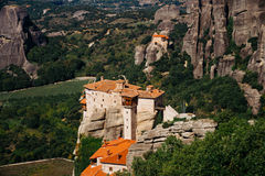 Meteora monasteries, the Holy Monastery of Varlaam at foreground, Greece Royalty Free Stock Image