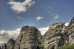 Meteora monastery. Scenic view of Meteora monastery on top of mountains, blue sky and cloudscape background, Greece royalty free stock photography