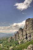 Meteora monastery. Scenic view of Meteora monastery on mountain range summit with blue sky and cloudscape background, Greece royalty free stock images