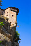 Meteora monastery and lifting cage in Greece Royalty Free Stock Image