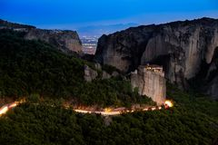 Meteora monasteries from Greece at sunset. The Meteora is a rock formation in central Greece hosting one of the largest and most precipitously built complexes of stock photography