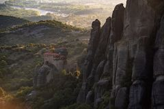 Meteora monasteries from Greece at sunset. The Meteora is a rock formation in central Greece hosting one of the largest and most precipitously built complexes of royalty free stock images