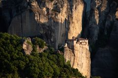 Meteora monasteries from Greece at sunset. The Meteora is a rock formation in central Greece hosting one of the largest and most precipitously built complexes of stock photos