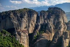Meteora monasteries from Greece at sunset. The Meteora is a rock formation in central Greece hosting one of the largest and most precipitously built complexes of royalty free stock photography