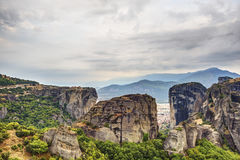 Meteora rock formations and monasteries. Landscape view of the amazing rock formations and monasteries in Meteora, Greece Royalty Free Stock Image