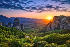 Meteora & Sunset. Photo of the panoramic view of the meteora valley at sunset Stock Photo