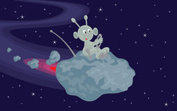 Meteorite. Funny alien flies on a small asteroid in space Stock Images