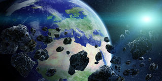 Meteorite impact on planet Earth in space Royalty Free Stock Images
