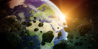 Meteorite impact on planet Earth in space Stock Images