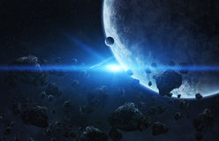 Meteorite impact on a planet in space Stock Photos