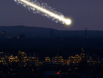 Meteorite. A large bright meteorite is dragging a long trail of light across the sky stock image