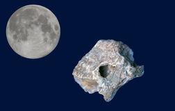 Meteorite and the moon. Meteorite with the moon in the space stock photos