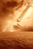 Meteorite on the ocean. And lightning Royalty Free Stock Photo