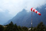 Meteorological red white windsock in Himalaya airport,Nepal Stock Photos