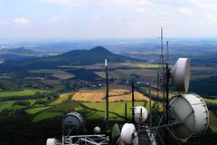 Meteorological satellites on Milesovka. View from czech mountain Milesovka with weather satellite dishes. On the mountain Milesovka is situated meteorological stock image