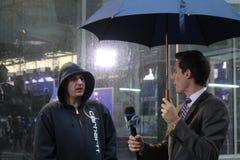 Meteorologist Jeff Smith reporting Hurricane Sandy stock photography