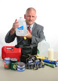 Meteorologist With Water. A meteorologist with hurricane supplies, holding up a jug of water Royalty Free Stock Image