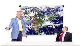 Meteorologistas atrás de uma mesa da escora Imagem de Stock Royalty Free