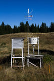 Meteorology equipment in white measuring container high in the mountain,vertical. Meteorology equipment in the field Stock Photography