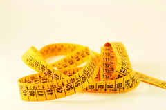 Meter. A closeup of a measuring tape Royalty Free Stock Photo