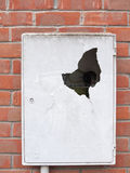 A meter box broken into outside with cracked dent hole old dange Royalty Free Stock Photography