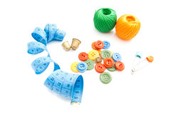 Meter, buttons, thread and thimbles Royalty Free Stock Photo