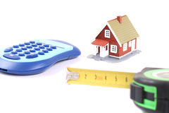 Meter, calculator and little house over white. Stock Photo