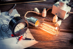 Meter and electric light bulb in the laboratory Stock Photography
