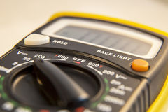 Meter. Electric test meter lying on a table Royalty Free Stock Photo