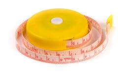 Meter för skräddare` s eller automatisk måttband som isoleras på en vit bakgrund Royaltyfria Bilder