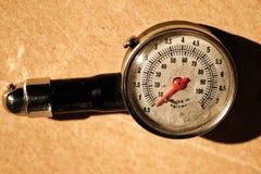 Meter gauge air tires Stock Images