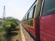 In Meter gauge Railway track at public park tourist are enjoying safari. stock photo