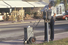 A meter man emptying a parking meter Stock Images