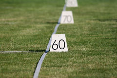Meter markers on stadium. Meter markers on sports stadium Stock Images