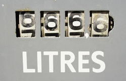 Meter on old gas pump forming 666,6. A closeup on the meter of an old gas pump, showing a total of 666,6 litres Stock Images