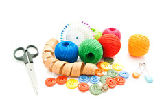 Meter, pins, scissors, buttons and colored thread Royalty Free Stock Photo