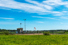 Meter Site. For petrochemical plant in farm field Against cloudy blue-sky background Royalty Free Stock Photos