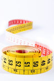 Meter tape vertical. Yellow meter tape vertical on white background Royalty Free Stock Photography