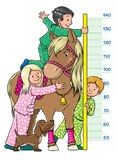 Meter wall with children and a pony. Meter wall or height meter with one girl and two boys, which measures the growth of pony Royalty Free Stock Photo