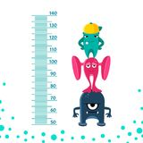 Meter wall or height meter from 50 to 140 centimeter with cute monsters. Royalty Free Stock Photo