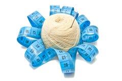 Meter and white yarn Stock Image