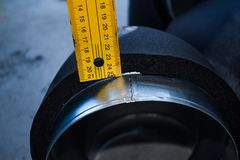Metering insulation thickness of galvanized steel duct stock photography
