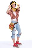 Metering rule. Young woman with tool belt is holding a square-folded metering rule in front of her face Stock Photo
